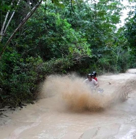 ATV driving through a puddle
